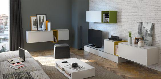 Ambiente con composición de muebles, aparador y mesa de centro.