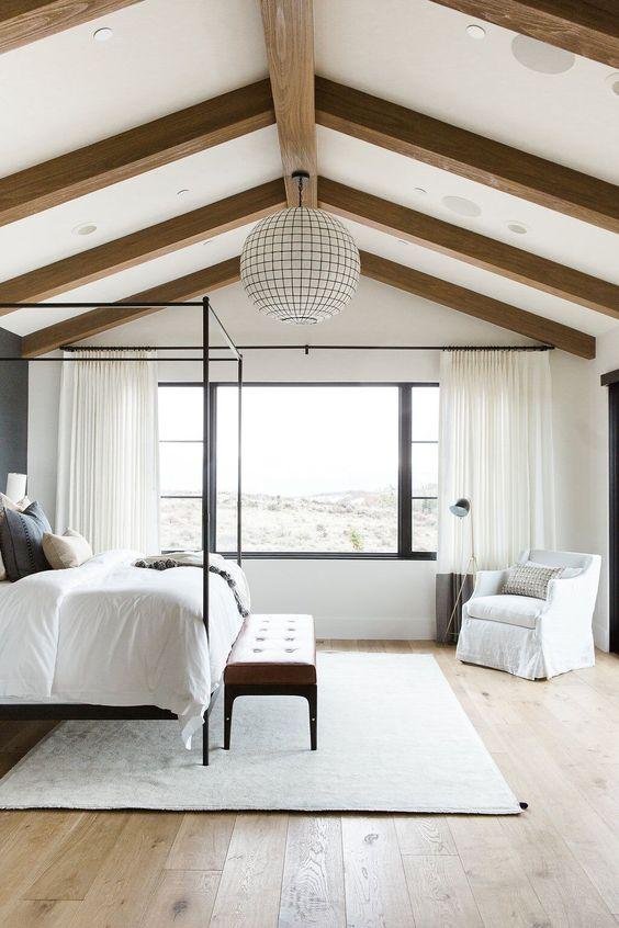 Decorar dormitorios de matrimonio abuhardillados