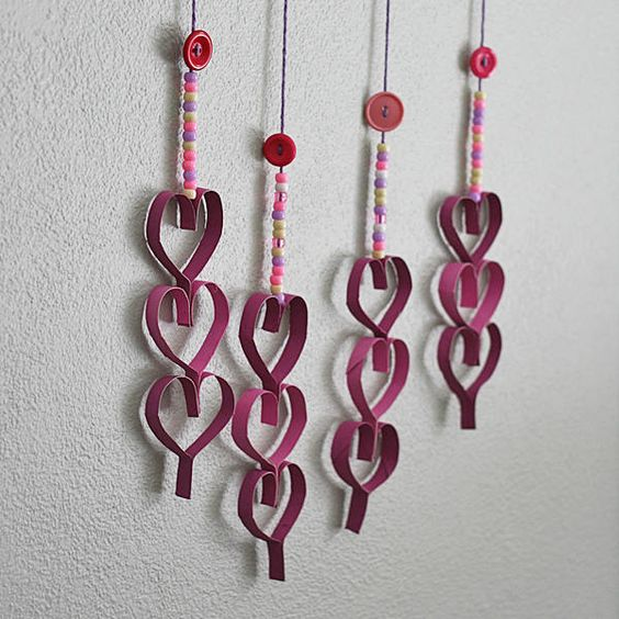 https://craftsbyamanda.com/cardboard-tube-dangling-hearts/