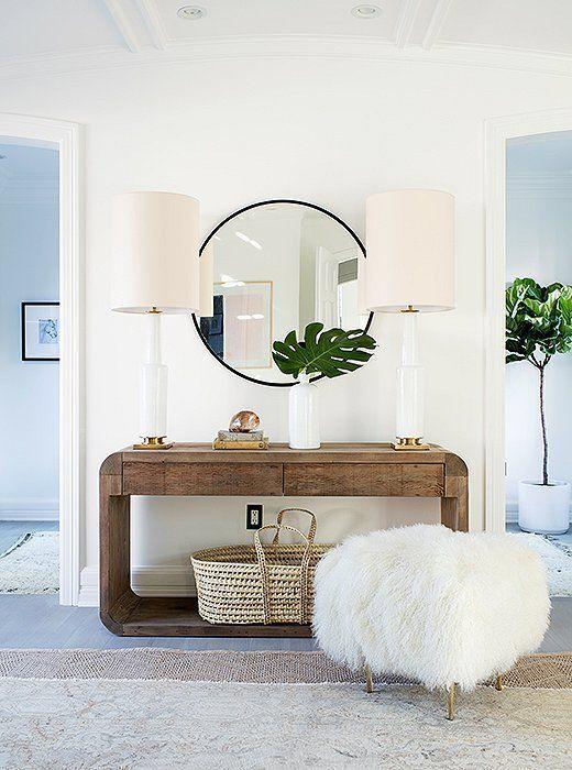Tendencia espejos redondos en el recibidor