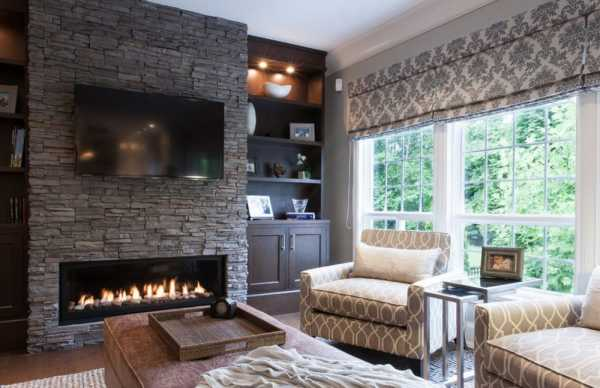 Diez salones con pared de piedra decofaci n hogar for Piedra barata para paredes